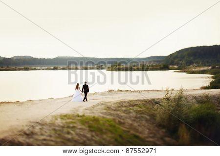 Wedding Loving Couple Runs Along The Beach