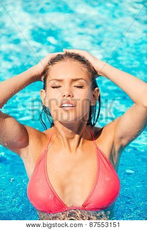 Beautiful Woman At The Pool.