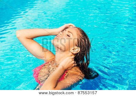Beautiful Woman At The Pool.