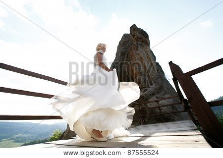 Bride Spins Between The Mountains Against The Sky