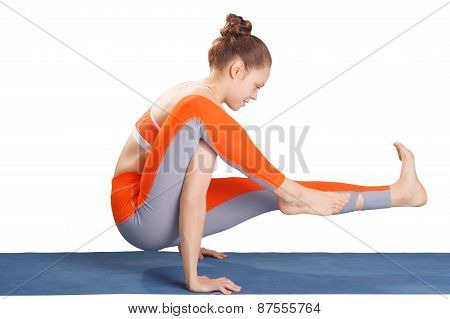 Young Beautiful Yoga Posing On A White Studio Background