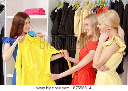 Women go shopping together