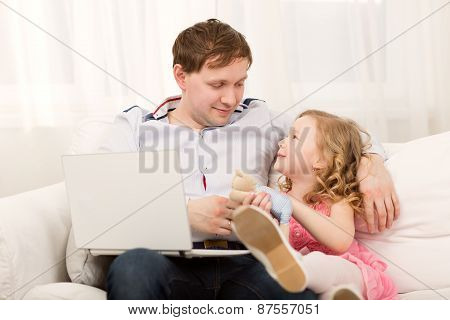 Daughter wants to play with busy dad