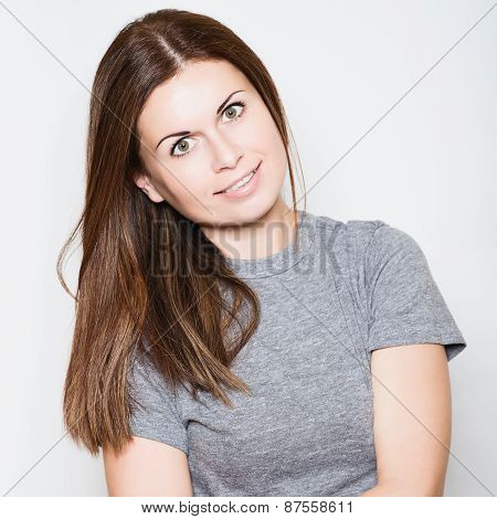 Beautiful Young Woman Smiling On White Background