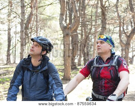 Two Men On Bicycles.