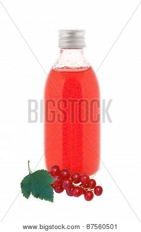 Close Up On A Medicine Bottle With Red Syrup And Fresh Currant Isolated On White