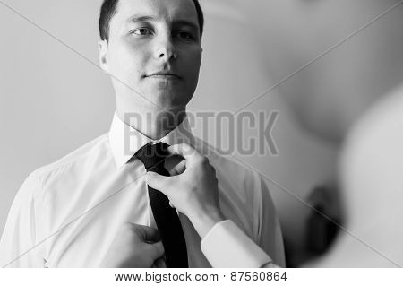 Bridegroom Preparing For The Wedding, Corrects A Beautiful Balck Tie