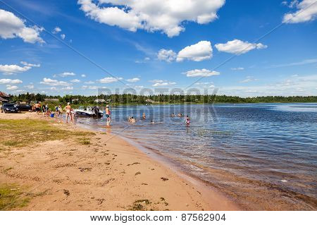 People Relax On The Lake In Summer Sunny Day