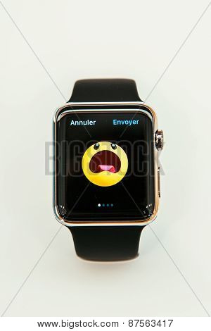 Apple Watch with emoji on screen