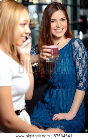 Girl friends have a drink in the bar