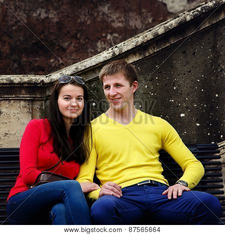 Couple Sitting On A Bench In The Garden Of The Vatican In Rome, Italy