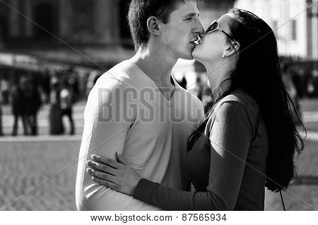 A Couple Of Tourists Smiling And embrace On The Central Square Of The Vatican