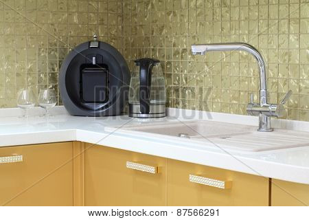 Modern stainless steel tap and sink in the luxurious kitchen