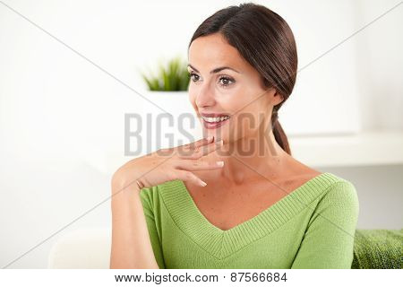 Confident Young Woman Looking Away At Home