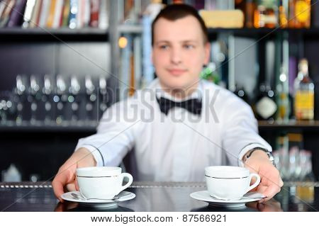Barman stretches out coffee