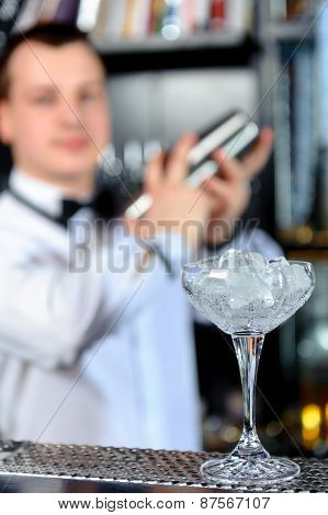 Barman makes tasty cocktails