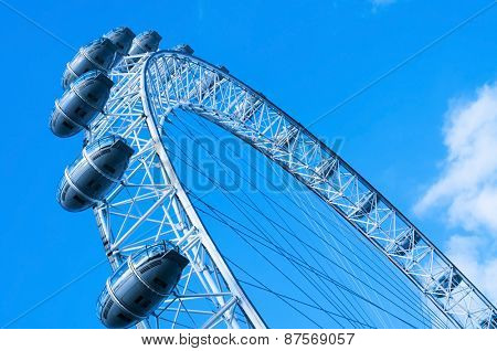 LONDON, UNITED KINGDOM - JANUARY 19: Detail of the London Eye against the blue sky on January 19, 2015 in London, United Kingdom. It is the tallest Ferris wheel in Europe with 135 meters high