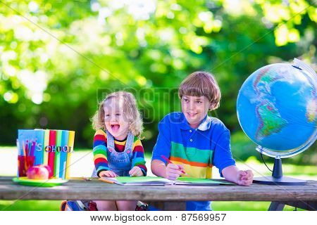Children Doing Homework In School Yard