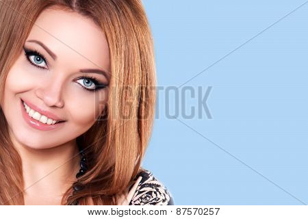 Closeup Beauty Women's Smile With Healthy Whiten teeth. Perfect Fresh Skin.