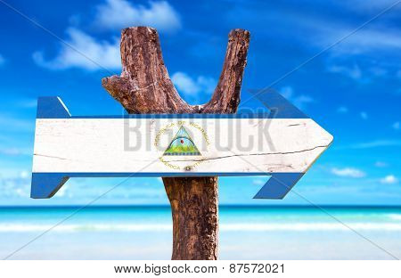 Nicaragua Flag wooden sign with beach background