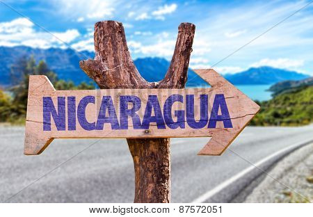 Nicaragua wooden sign with road background