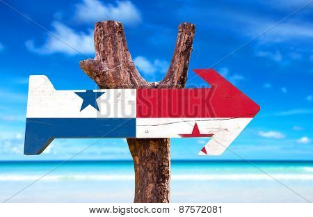 Panama Flag wooden sign with beach background