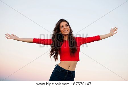 Beautiful young woman relaxing in the countryside with beautiful light