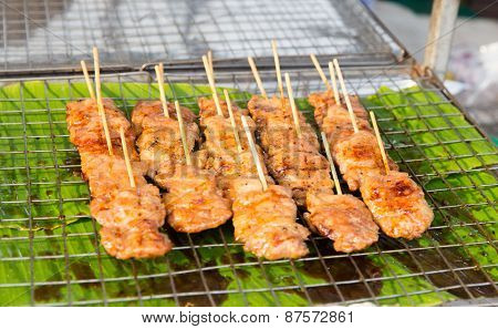 cooking, asian kitchen, sale and food concept - meat grill at street market