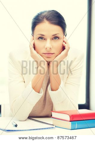 picture of bored and tired woman behid the table