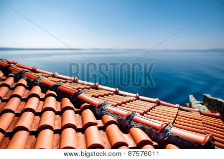 Red tile roof on the sea background