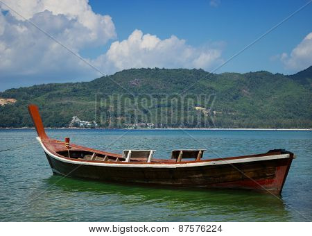 Thai Wooden Boat On A Calm Sea Bay