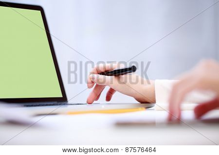 Woman analyzing something at laptop.