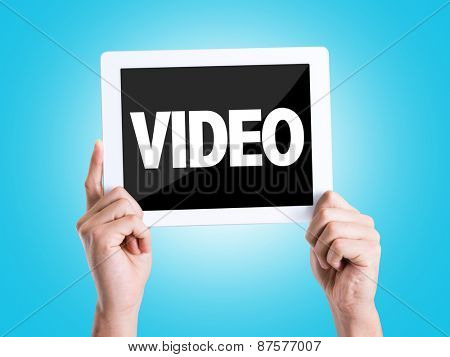 Tablet pc with text Video with blue background