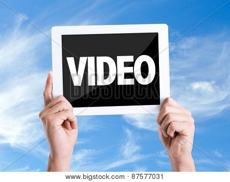 Tablet pc with text Video with sky background