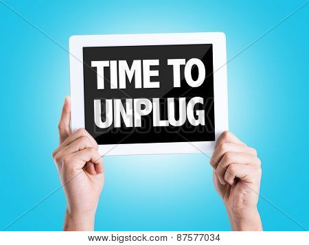 Tablet pc with text Time To Unplug with blue background