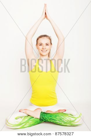 young beautiful yoga posing  over white background