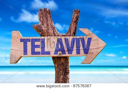 Tel Aviv wooden sign with beach background