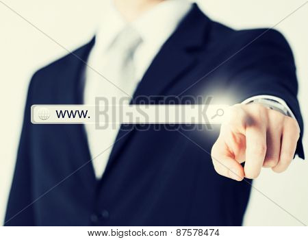 technology, searching system and internet concept - businessman pressing Search button