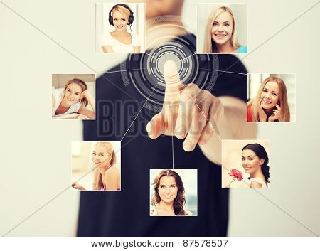 technology and communication - man pressing button on virtual screen with contact icons