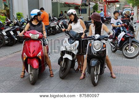 Young Women On Motorbike