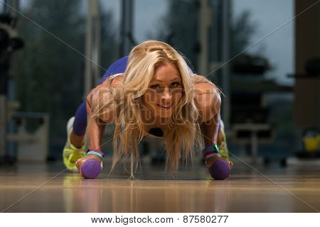Middle Age Woman Exercising Push Ups
