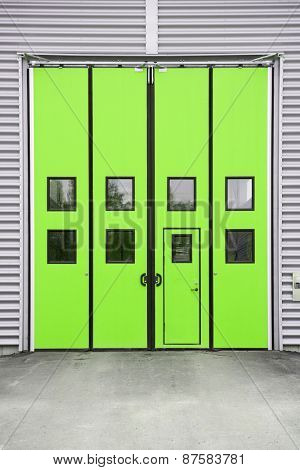 Green Garage Door on a warehouse building