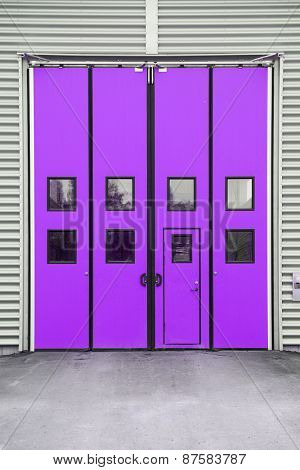 Purple Garage Door on a warehouse building