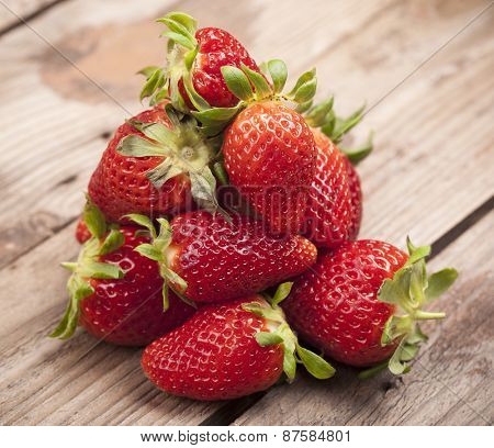 Closeup of fresh strawberries on wooden background