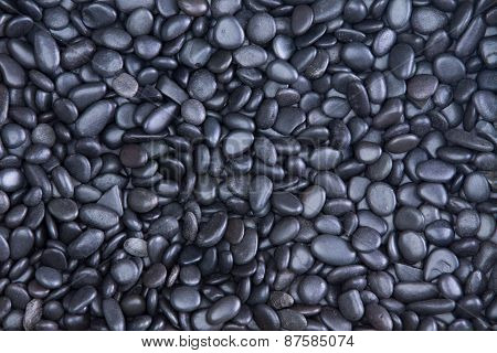 Background Texture Of Waterworn Black Pebbles