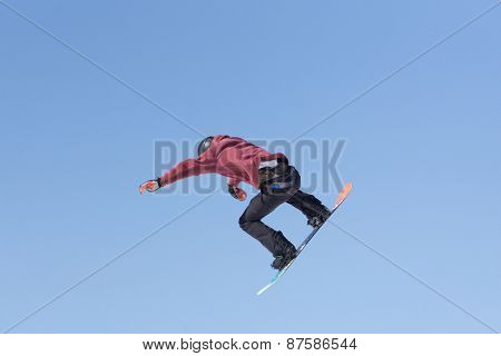Snowboarder jumps in Snow Park, big air