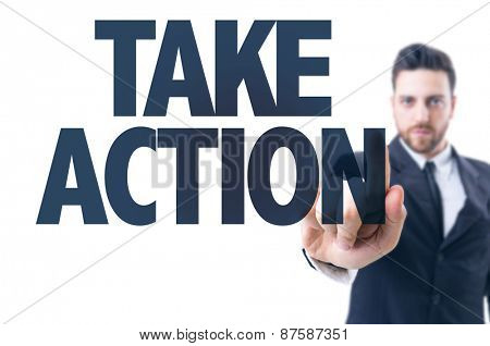 Business man pointing the text: Take Action