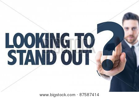 Business man pointing the text: Looking to Stand Out?