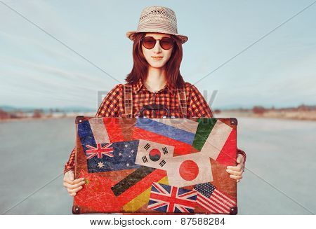 Smiling Traveler Woman Holding Suitcase