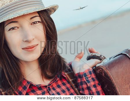 Smiling Tourist Girl With Suitcase